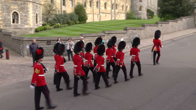 queen elizabeth ii today celebrated her 90th birthday shows the coldstream guards marching out of windsor castle - honour guard stock videos & royalty-free footage