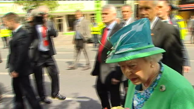 queen elizabeth ii visit: day 4; cork: crowd gathered to see the queen held back behind lines of security and barriers reporter to camera sot queen... - royalty stock videos & royalty-free footage