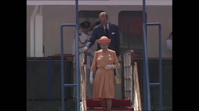"queen elizabeth ii visit to malta; malta: ext vv warship ""battleaxe"" escorting ""britannia"" sailors onboard standing to attention bv ""britannia""... - yacht stock videos & royalty-free footage"