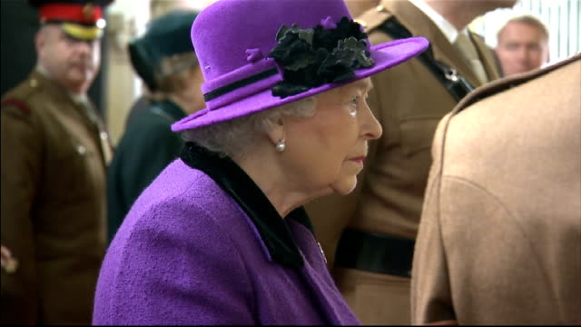 Queen Elizabeth II visits barracks near Windsor Queen being shown horses close to retirement Horses being schooled / red carpet laid down on sand of...