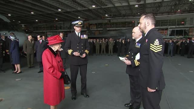 queen elizabeth ii visits hms queen elizabeth; england: hampshire: portsmouth: int ship queen elizabeth ii meeting crew members in hangar deck of... - queen royal person stock videos & royalty-free footage