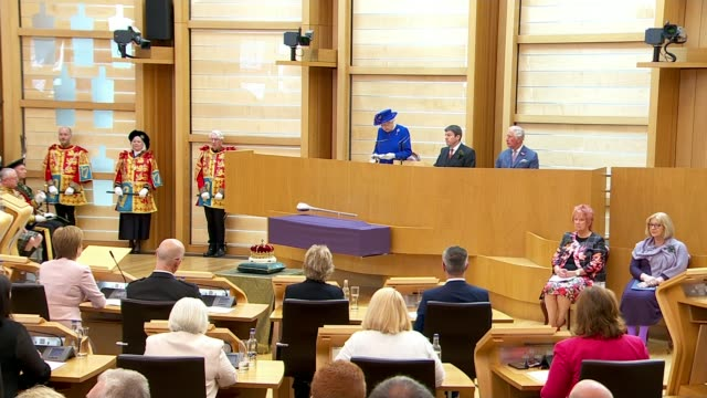 queen elizabeth ii visits holyrood to mark 20th anniversary of scottish parliament; scotland: edinburgh: ext queen elizabeth ii and prince charles,... - royal blue stock videos & royalty-free footage