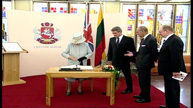 Queen Elizabeth II visits Lithuania / speech to parliament **BEWARE Queen Elizabeth II towards down steps with officials along to guest book / Queen...