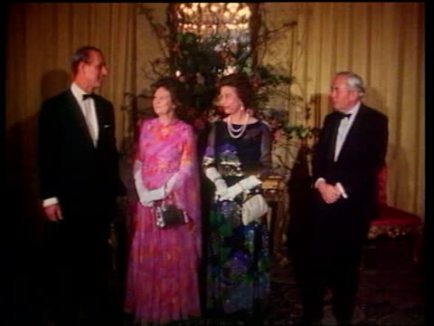 queen elizabeth ii visits no 10 downing street for third time in her reign 1976 / tx queen and philip posing with pm harold wilson and wife mary for... - harold wilson stock-videos und b-roll-filmmaterial