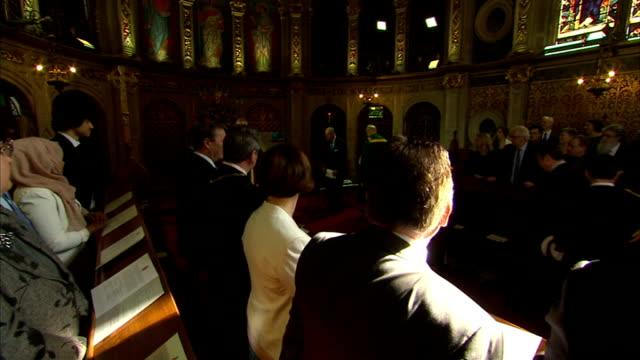 queen elizabeth ii visits royal holloway, university of london; queen elizabeth ii along in chapel accompanied by professor paul layzell and followed... - choir stock videos & royalty-free footage