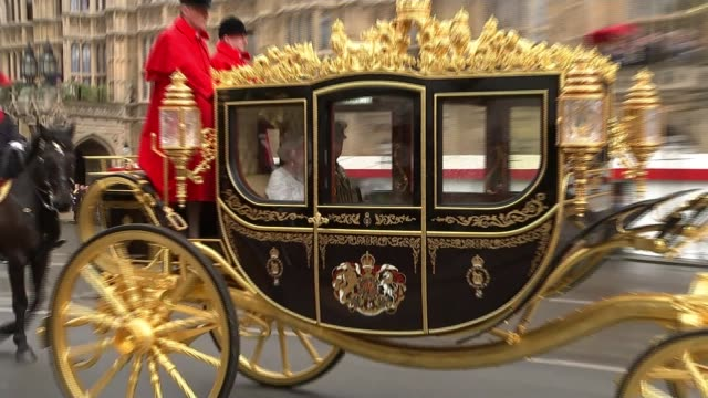 government uturn on police funding t18051604 tx queen elizabeth ii waving from carriage as along for state opening of parliament int queen speaking... - the queen's speech state opening of uk parliament stock-videos und b-roll-filmmaterial