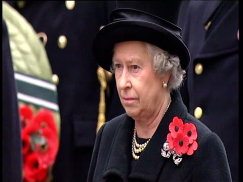 queen elizabeth ii wearing group of poppies on left shoulder at remembrance day service 09 nov 03 - memorial event stock videos and b-roll footage