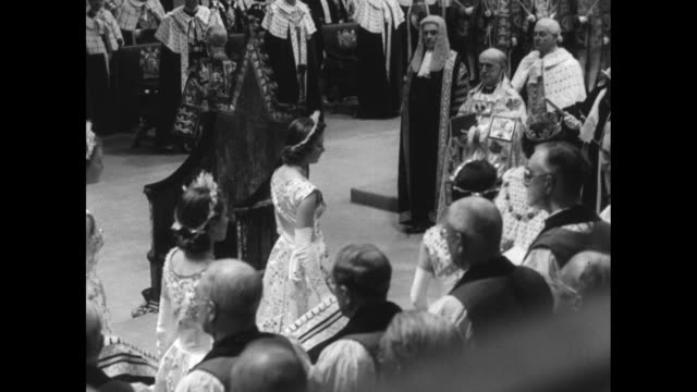 queen elizabeth ii's maids of honor carry the train of her coronation gown as she walks towards king edward's chair to meet the archbishop of... - archbishop of canterbury stock videos & royalty-free footage