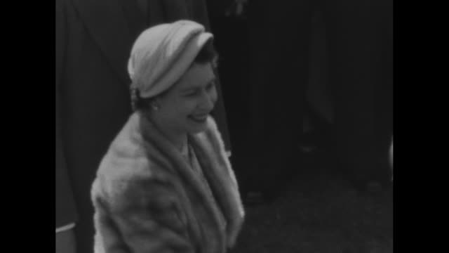 queen elizabeth in fur stole and prince philip duke of edinburgh greeting native indian couple and other dignitaries at precoronation garden party - 1953 stock videos and b-roll footage