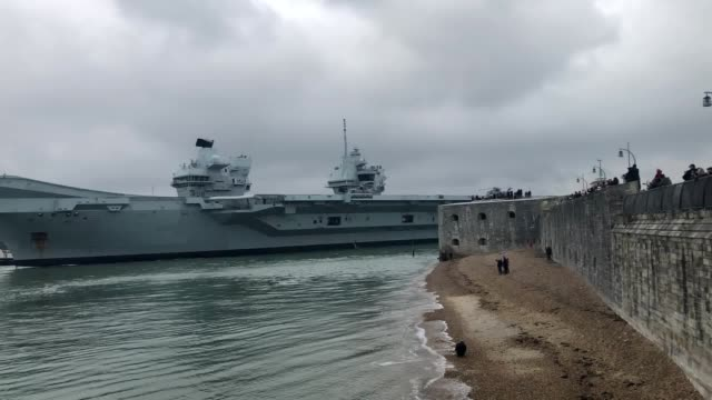 queen elizabeth leaves portsmouth harbour for flight trials. the carrier, which is currently stationed in the hampshire city's naval base, is... - aircraft carrier stock videos & royalty-free footage