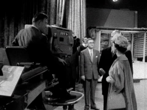 Queen Elizabeth meets one of the cameramen in the Crackerjack studio during her tour of BBC Television Centre 1961