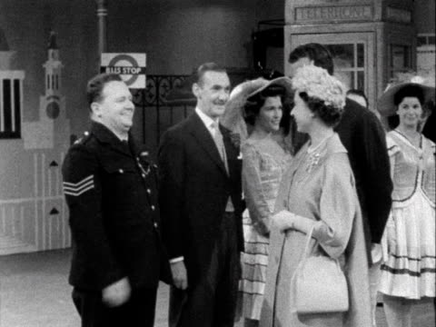 queen elizabeth meets the cast of crackerjack, including harry secombe during her tour of bbc television centre. 1961. - harry secombe stock videos & royalty-free footage