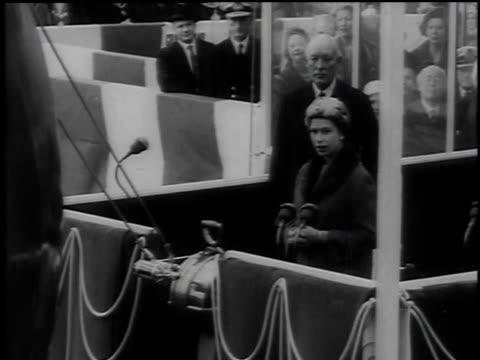 vidéos et rushes de queen elizabeth names the ship at a podium and pulls a lever / united kingdom - 1960