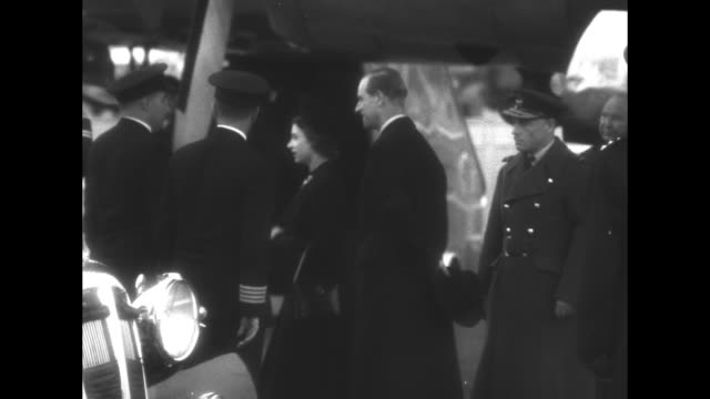 Queen Elizabeth on tarmac of London Airport meeting numerous dignitaries she and Prince Philip shake hands with pilots / she and Prince Philip enter...