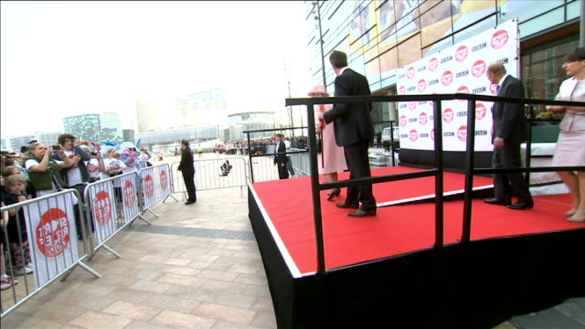 queen elizabeth opens bbc media city in salford ext various of queen elizabeth and prince philip onto platform in front of mediacityuk building... - start flag stock videos & royalty-free footage