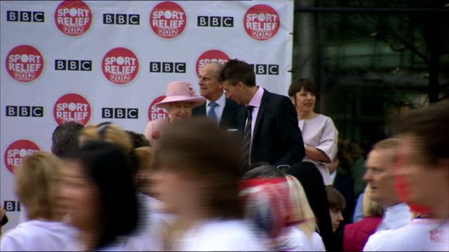 queen elizabeth opens bbc media city: sport relief mile; england: greater manchester: salford: bbc mediacityuk: ext various of queen elizabeth... - salford quays stock videos & royalty-free footage