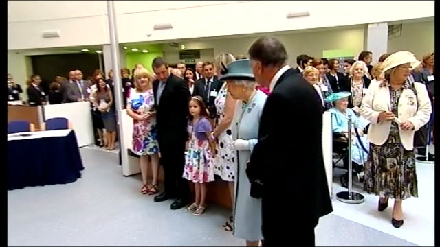 queen elizabeth opens new hospital in stirling; queen applauded by staff and guests as into reception area/ queen elizabeth talking to elderly woman... - stirling stock videos & royalty-free footage