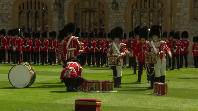 queen elizabeth presents new colours to welsh guards; england: berkshire: windsor: windsor castle: ext **intermittent military music throughout**... - examining stock-videos und b-roll-filmmaterial