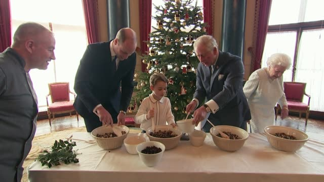 queen elizabeth, prince charles, prince william and prince george prepare christmas pudding; england: london: buckingham palace: int prince george... - raw footage stock videos & royalty-free footage