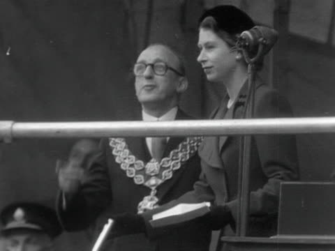 queen elizabeth pulls a lever to start the newly constructed claerwen dam at it's official opening ceremony. 1952. - peerage title stock videos & royalty-free footage