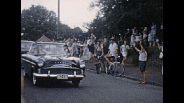 queen elizabeth queen mother driving past a crowd in hamilton new zealand - new zealand culture stock videos and b-roll footage