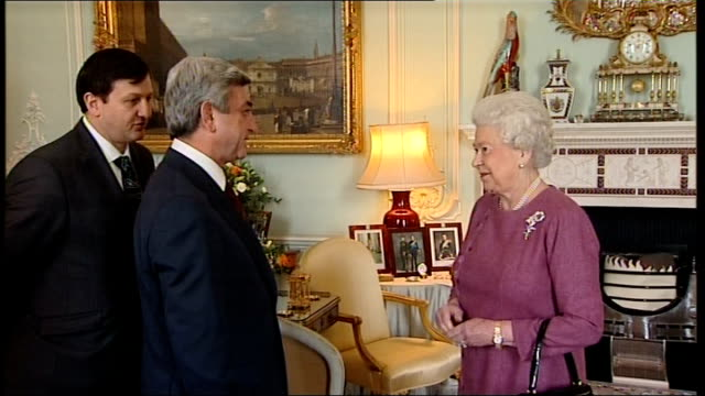 vídeos de stock, filmes e b-roll de queen elizabeth receives president of armenia at buckingham palace england london buckingham palace int serzh sargsyan announced by footman enters... - 2010