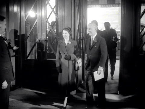 Queen Elizabeth the Duke of Edinburgh and Sir Alexander Cadogan enter BBC Broadcasting House and meet Vice Chairman Lord Tedder Director General Sir...