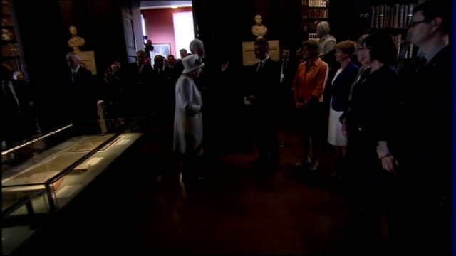 queen elizabeth visit: queen visits trinity college library; republic of ireland: dublin: trinity college: int ** harp music heard over the following... - dublin republic of ireland stock videos & royalty-free footage