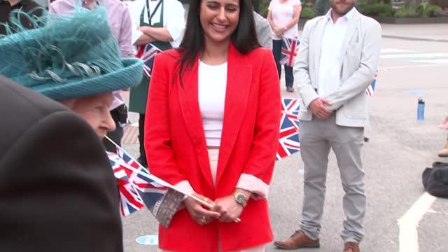 queen elizabeth visits coronation street set; england: manchester: coronation street set: ext queen elizabeth ii meeting cast including charlie de... - soap opera stock videos & royalty-free footage