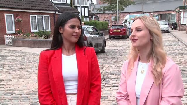 queen elizabeth visits coronation street set; england: manchester: coronation street set: ext sair khan and tina o'brien interview sot - soap opera stock videos & royalty-free footage