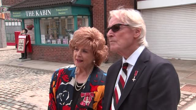 """queen elizabeth visits coronation street set; england: manchester: coronation street set: ext barbara knox and william roache interview sot. """"they... - soap opera stock videos & royalty-free footage"""