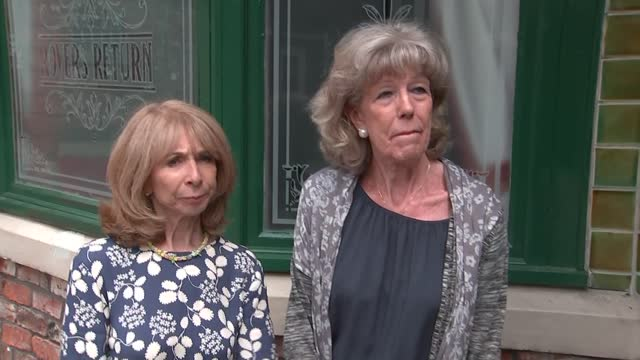 """queen elizabeth visits coronation street set; england: manchester: coronation street set: ext susan nicholls and helen worth interview sot. - """"this... - soap opera stock videos & royalty-free footage"""