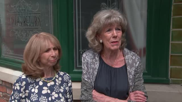 """queen elizabeth visits coronation street set; england: manchester: coronation street set: ext susan nicholls and helen worth interview sot. """"it's not... - soap opera stock videos & royalty-free footage"""