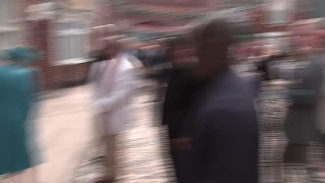 queen elizabeth visits coronation street set; england: manchester: coronation street set: ext queen elizabeth ii meeting crew outside houses and... - soap opera stock videos & royalty-free footage