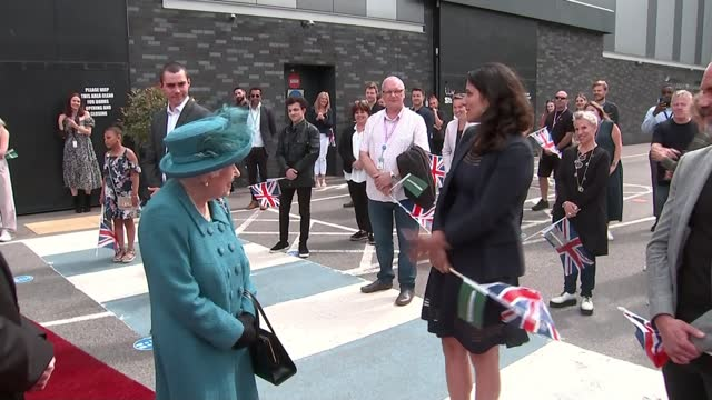 queen elizabeth visits coronation street set to mark 60 years of tv sop opera; england: manchester: itv studios: coronation street set: ext queen... - soap opera stock videos & royalty-free footage