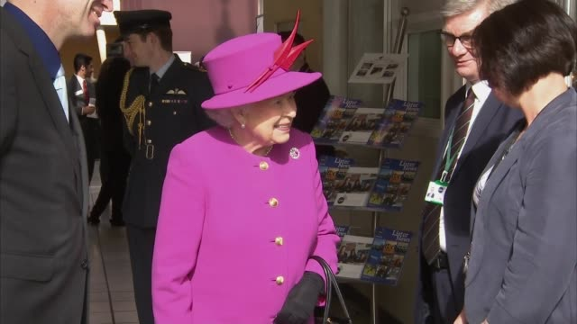 queen elizabeth visits lister community college queen unveiling plaque and signing visitors book / - book signing stock videos & royalty-free footage