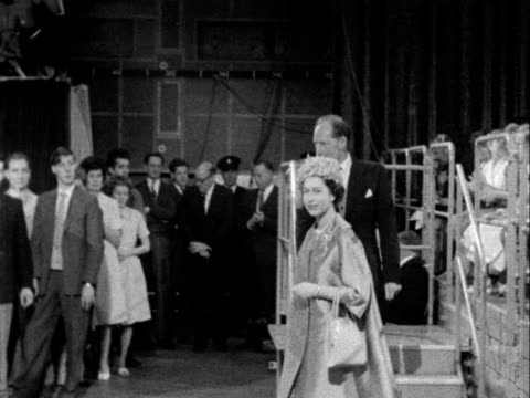 Queen Elizabeth walks into the Crackerjack studio and is greeted by Eamonn Andrews during her tour of BBC Television Centre 1961