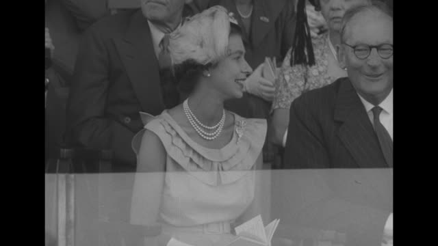 queen elizabeth with track chairman a g potter stand in enclosure at randwick race course examine racing sheet peer through binoculars / pan to... - elizabeth ii stock videos and b-roll footage