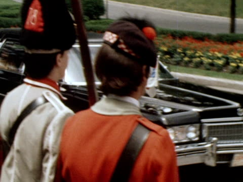 queen elizabeth's limousine and motorcade arrives at the olympic site in montreal for the 1976 olympic games. 18 july 1976. - モントリオール点の映像素材/bロール