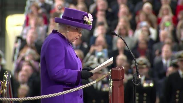 vidéos et rushes de queen formally commissions hms queen elizabeth aircraft carrier queen elizabeth ii speech sot people attending the ceremony including the chancellor... - royal navy