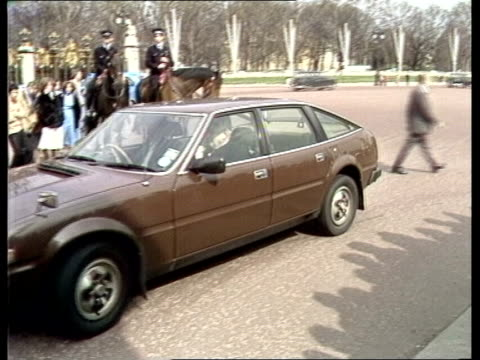 queen gives consent nao remains london pan car into palace gates with harold wilson ms ditto with lord hailsham dog on lap cms policeman watching ms... - harold wilson stock-videos und b-roll-filmmaterial