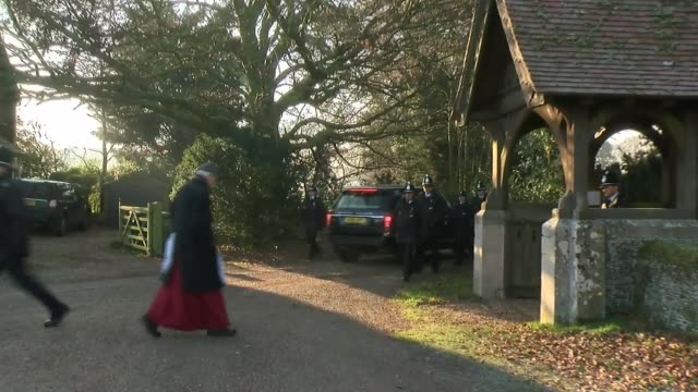 arrival and departure ENGLAND Norfolk Wolferton near Sandringham EXT St Peter Church / various of police press and the public standing outside /...