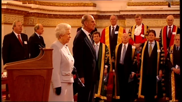 Queen hands out Queen's Anniversary Prizes for Higher and Further Education ENGLAND London Buckingham Palace EXT **flash photography throughout**...