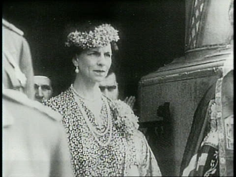 queen helen of romania is granted return from exile to romania in 1940 / man rings a large bell / queen helen steps off train and is welcomed to... - axis powers stock videos & royalty-free footage