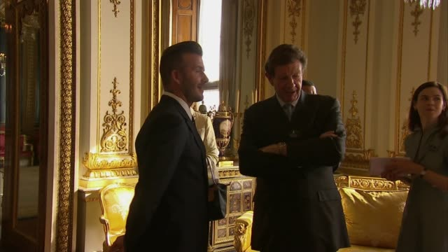 Queen holds reception for Young Leaders' Programme ENGLAND London Buckingham Palace David Beckham interview SOT / Beckham posing for photocall...