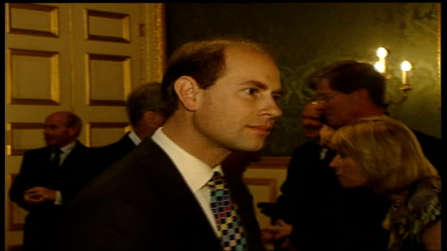 queen hosts association of royal yachtsmen reception; england: london: st james's palace: prince andrew stands chatting to people at reception,... - prince edward, earl of wessex stock videos & royalty-free footage