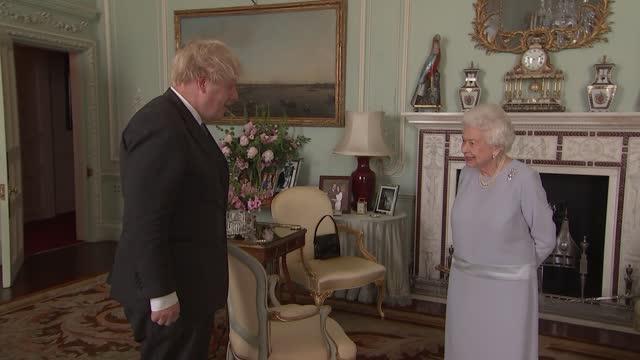 queen hosts boris johnson at buckingham palace; england: london: buckingham palace: int queen elizabeth ii stood on room / boris johnson mp announced... - text stock videos & royalty-free footage