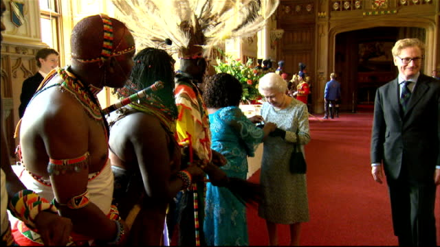 queen hosts drinks reception at windsor castle bvs duke of edinburgh speaking to performers / queen receives african bracelet and woman places them... - bracelet stock videos & royalty-free footage