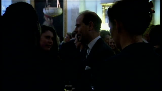Queen hosts reception at Buckingham Palace for Olympians and Paralympians Arrivals and GVs guests at reception Prince Edward Duke of Wessex chatting...