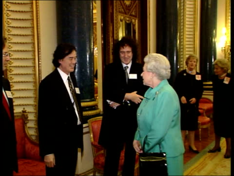 queen hosts reception for british music industry rushes london buckingham palace int gvs queen elizabeth ii and prince philip greeting dignatories at... - terry wogan video stock e b–roll